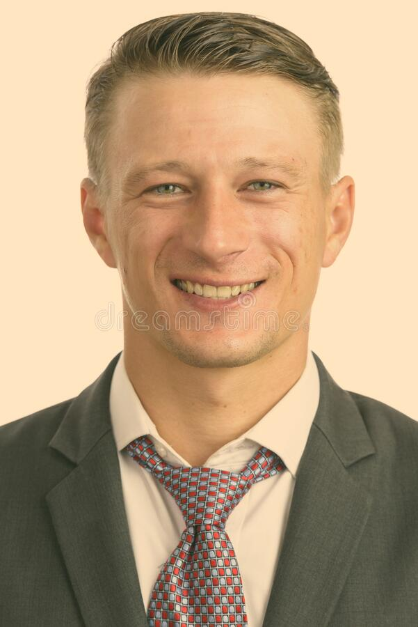 Portrait shot of young happy Caucasian businessman isolated against white background stock photo