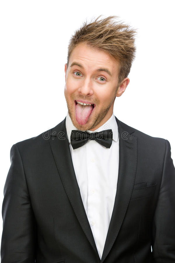 Portrait of showing tongue businessman. Half-length portrait of showing tongue businessman, isolated on white. Concept of fun and carefree stock photos