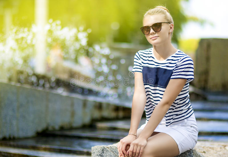 Portrait of Shy and Sensual Caucasian Teenage Girl Posing in Green Summer Park royalty free stock photos