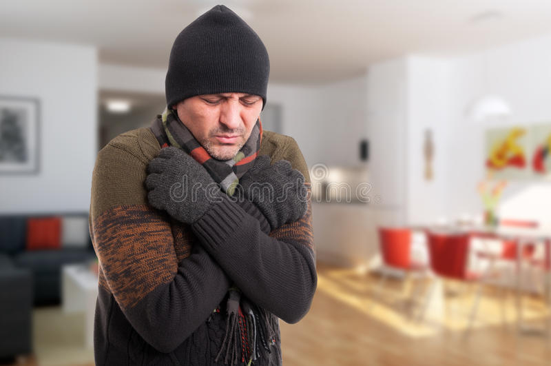 Portrait of sick man shivering from cold. Inside the house with copy text space royalty free stock photo