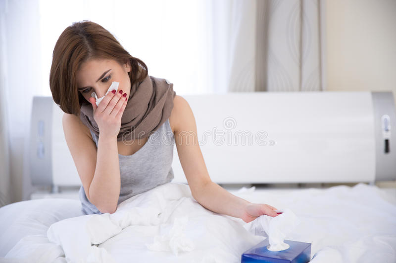 Portrait of a sick woman on the bed stock photo