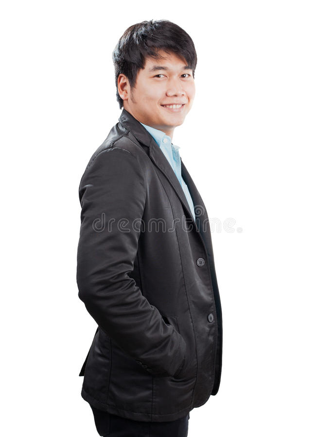 Portrait side view of young asian man with western suit standing stock photos