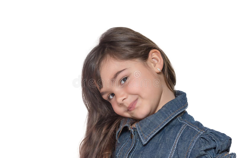 Portrait of simper little girl isolated. Portrait of simper brunette long haired little girl isolated on the white background. The little girl is looking at a royalty free stock photo