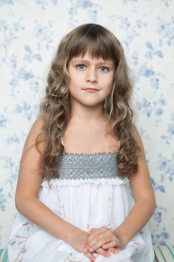 Portrait of sincere young grey-eyed girl child stock image