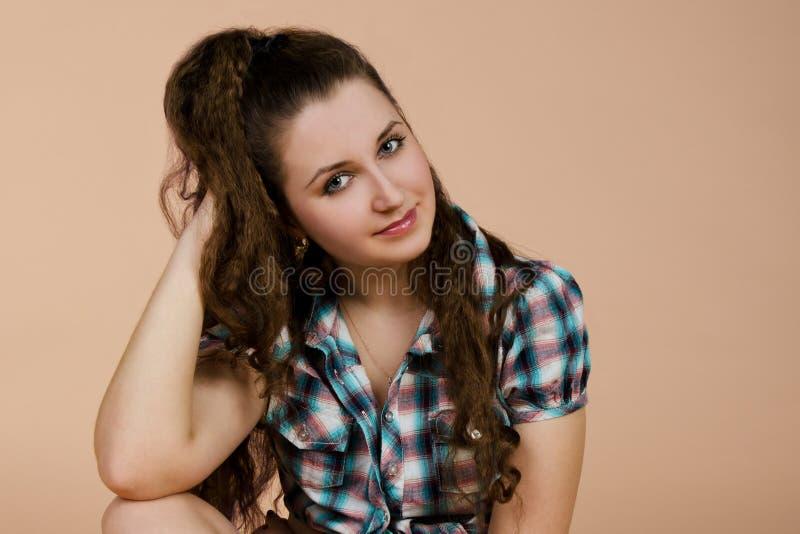 Download Portrait Of Sitting Beautiful  Brunette Woman Stock Photo - Image: 23988518