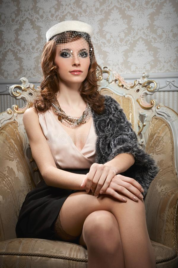 Portrait of sitting pretty young woman in retro style royalty free stock images