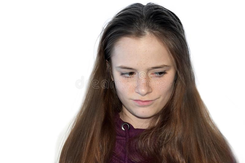 Portrait of a skeptical looking teenage girl stock image