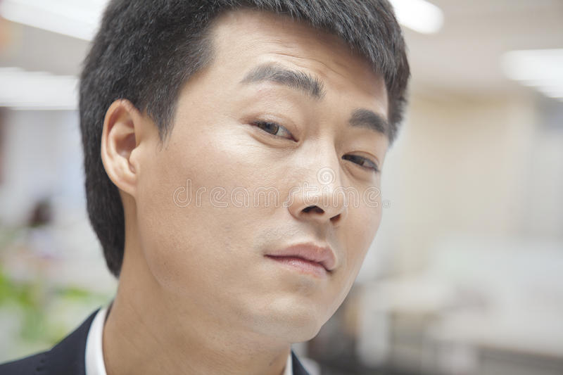 Portrait of Skeptical Mid Adult Man, Close-up, Looking At Camera stock photo