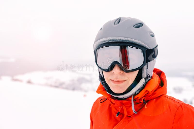 Portrait of a skier woman in helmet and ski goggles royalty free stock photography