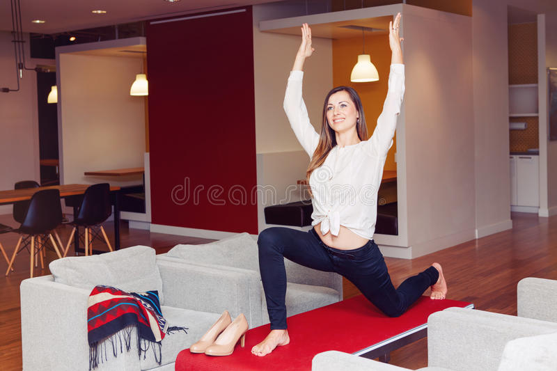 Portrait of slim fit sporty young white Caucasian business woman meditating doing yoga exercises. Portrait of slim fit sporty young white Caucasian business stock photos