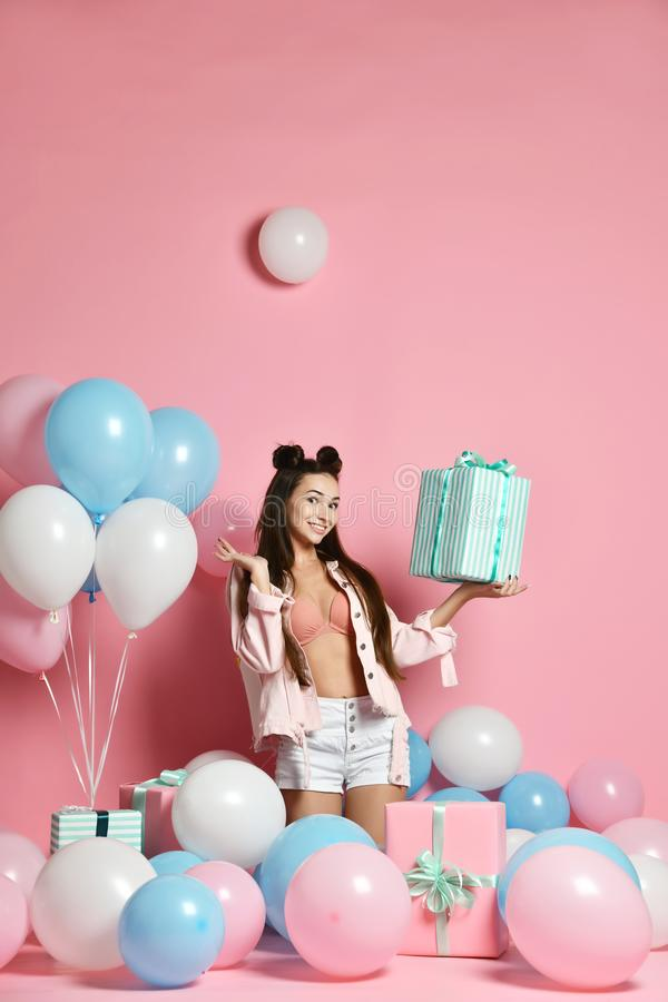 Portrait of beautiful girl resting at party over pink background. stock photos
