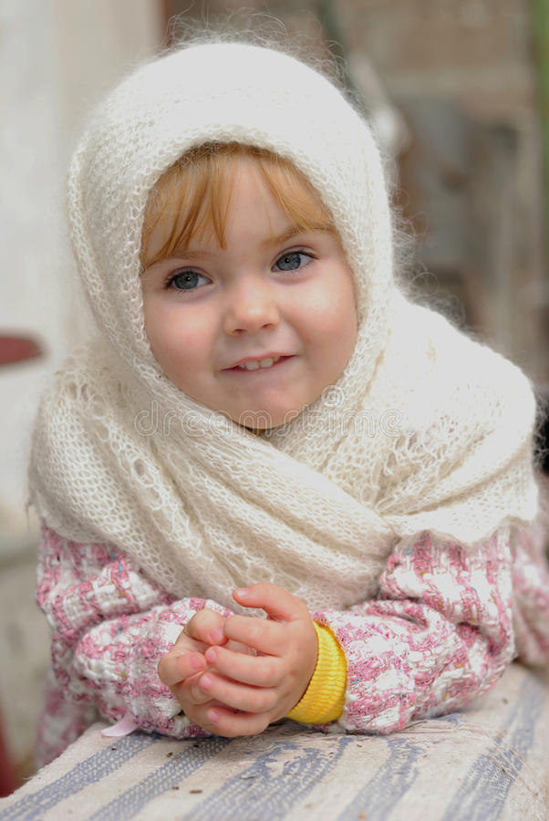 Download Portrait Of The Small Girl In The Scarf Stock Photo - Image: 23817894