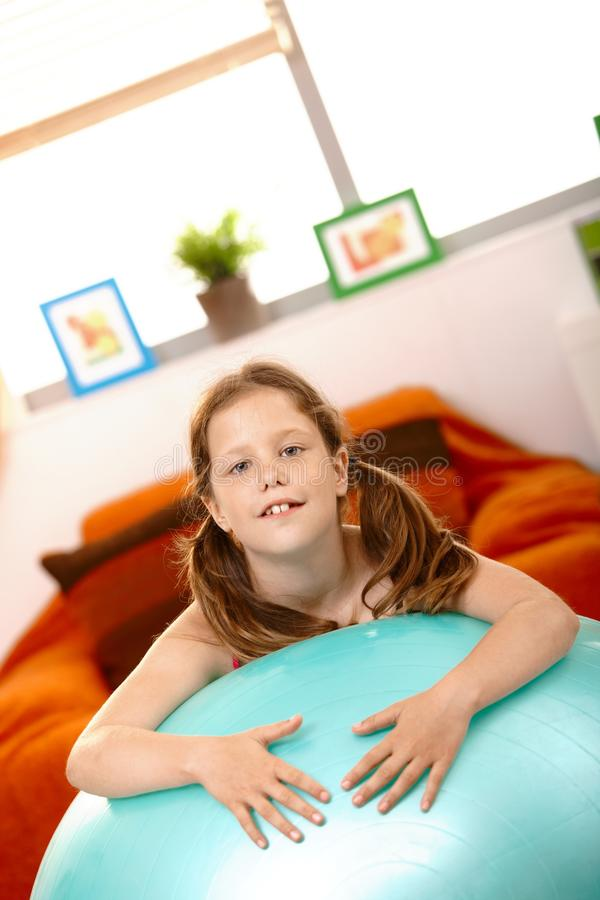 Portrait of small girl with sitting ball royalty free stock photography
