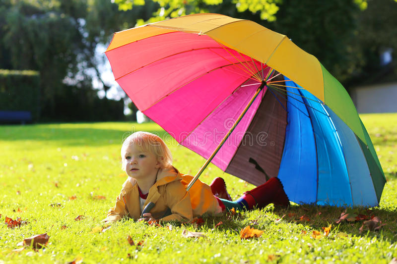 Portrait of small preschooler girl with colorful umbrella stock photos