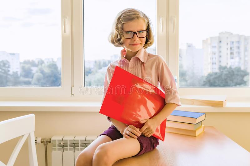 Portrait of small pretty student studying at desk stock photos