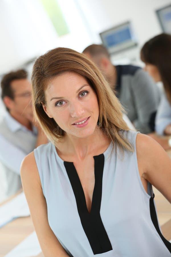 Portrait of smart businesswoman attending meeting stock images