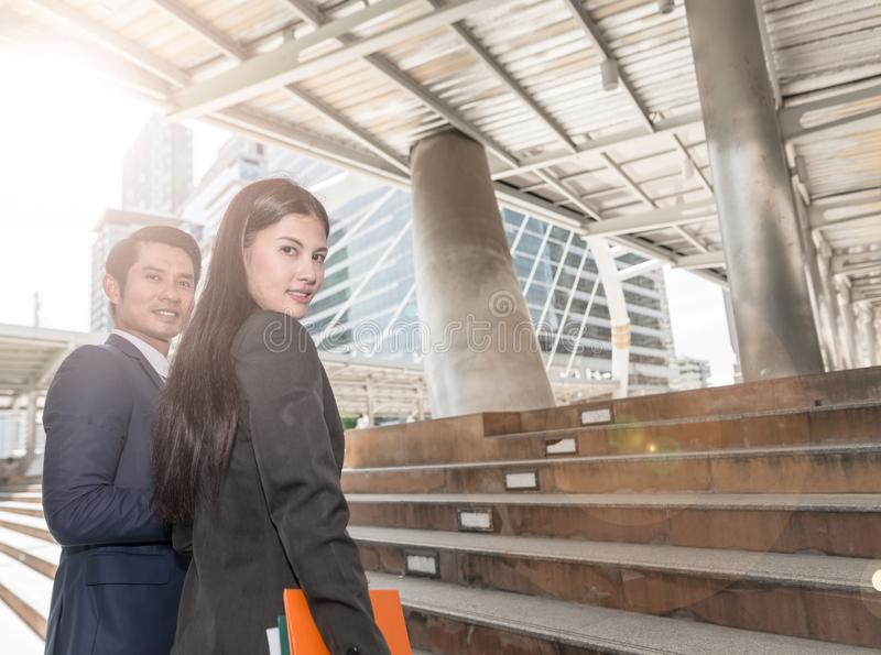 Portrait of smart confident business man boss and colleague business woman looking and smiling at camera, stock photo