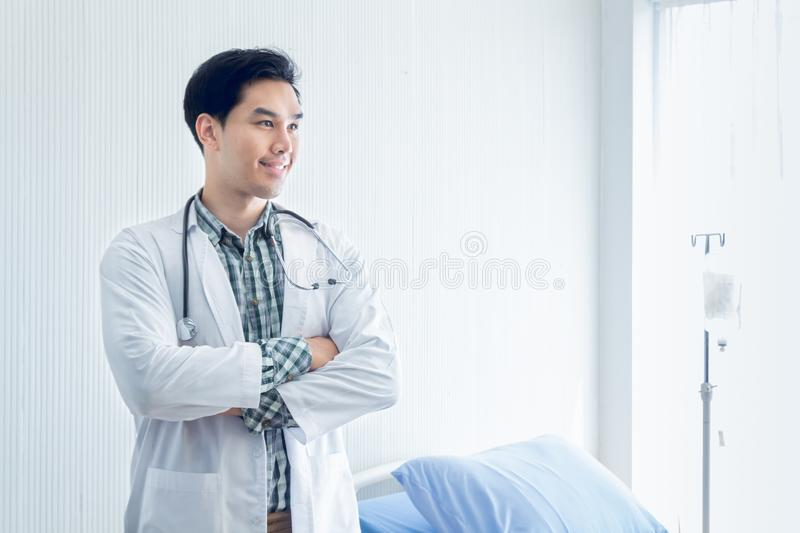 Portrait of a smart doctor standing in the medical room wait for diagnosing patient and treatment in new concept modern medicine royalty free stock image