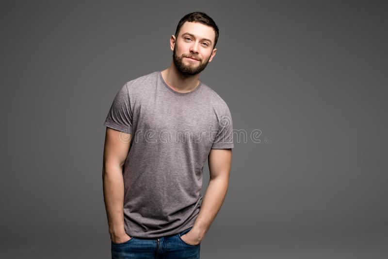 Portrait of a smart serious young man in casual clothes standing royalty free stock photo