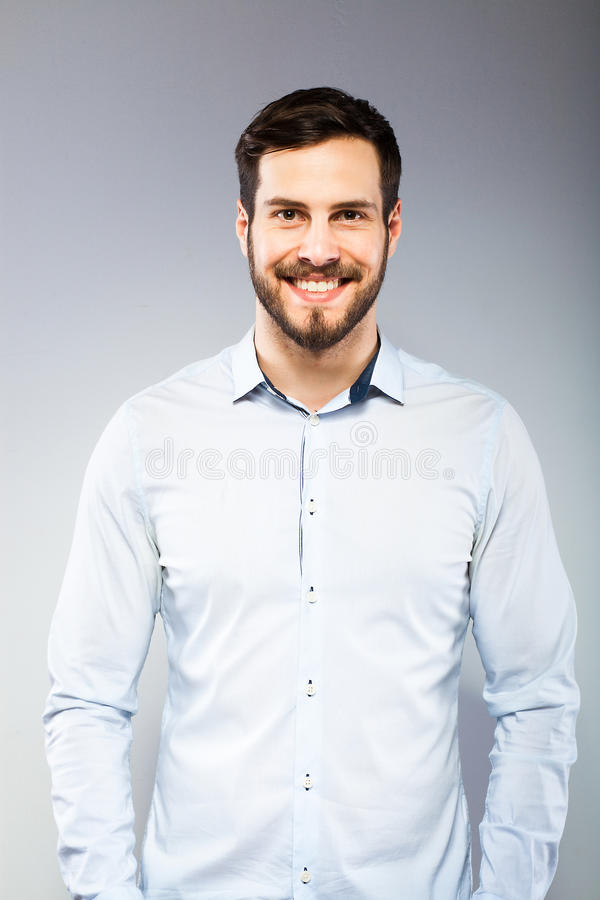 Portrait of a smart serious young man standing stock image
