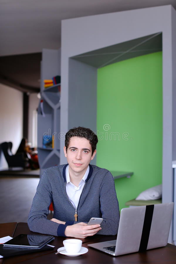 Portrait of smart young guy student who posing and looking in ca royalty free stock photography