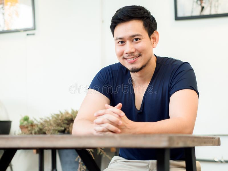 Portrait of smile man sits and relax in coffee cafe. stock photos