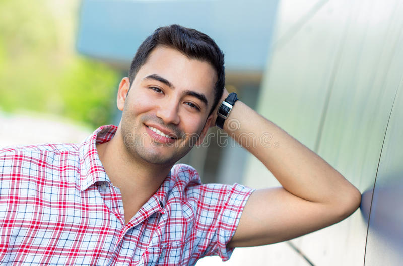 Portrait of a smile young man. Close up outside shot of happy gorgeous guy royalty free stock photos