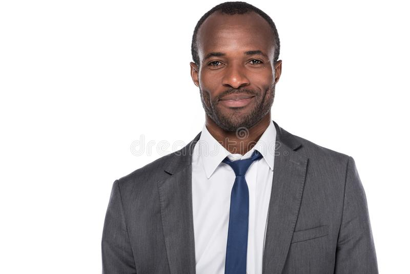 portrait of smiling african american businessman in suit stock images
