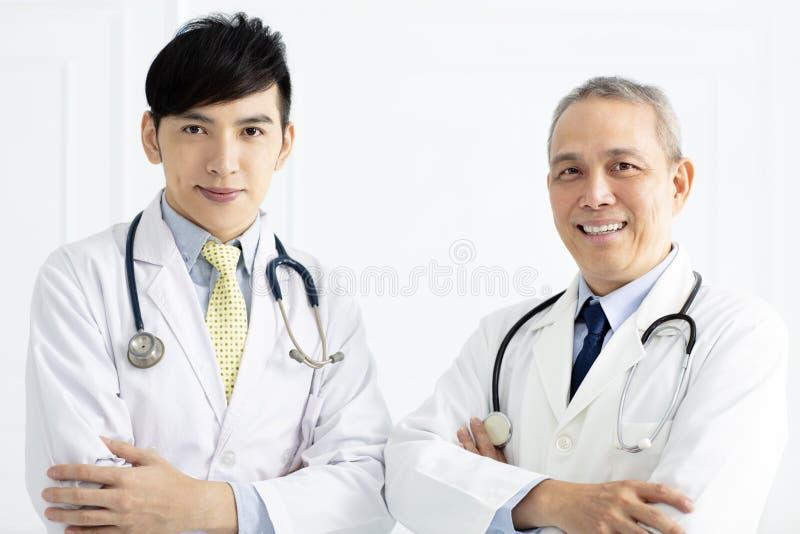 Portrait of smiling asian doctors stock image