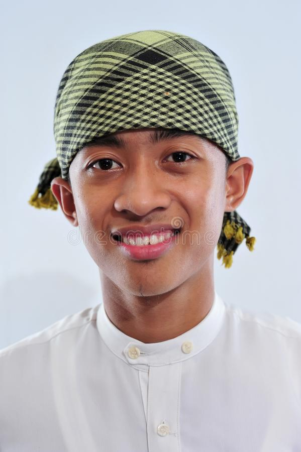 Portrait of smiling asian muslim man welcoming you stock images
