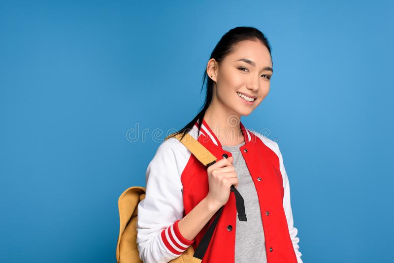 portrait of smiling asian student with backpack royalty free stock photos
