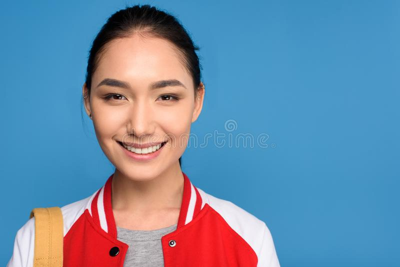 portrait of smiling asian woman looking at camera stock photography