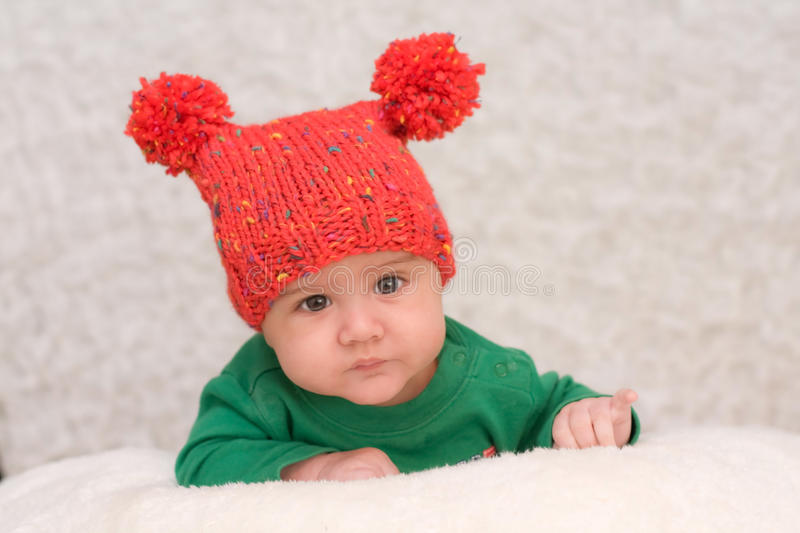 Portrait of smiling baby in red cap royalty free stock photos