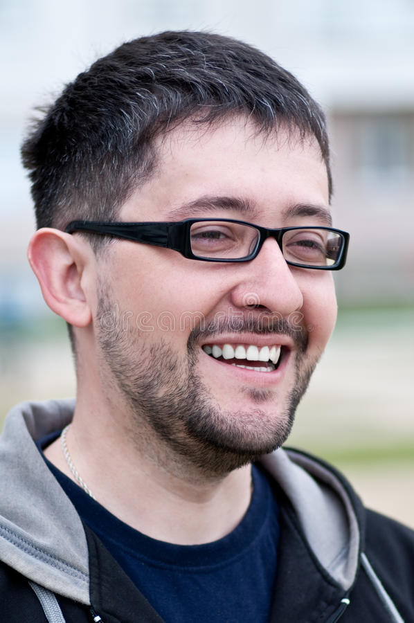Portrait of a smiling bearded man wearing glasses royalty free stock photos