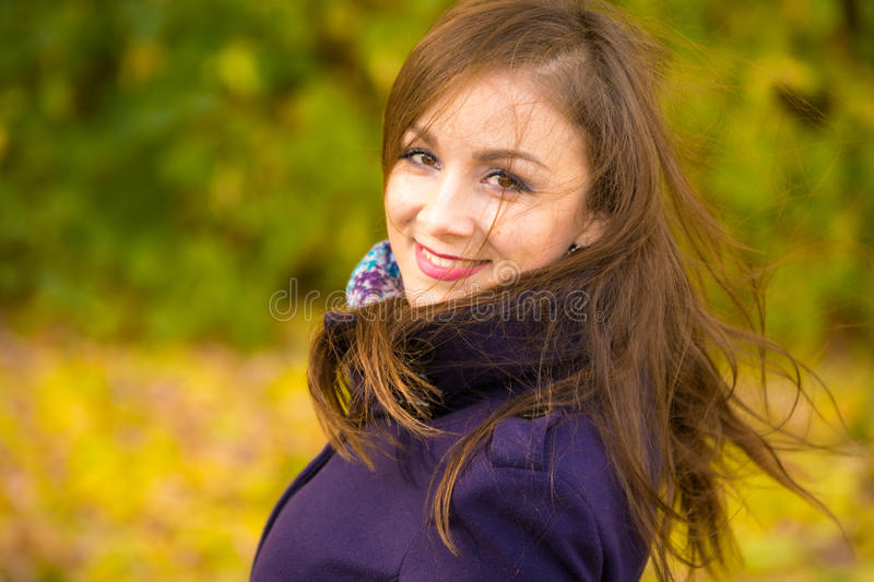 Portrait of smiling beautiful girl with disheveled hair royalty free stock photography