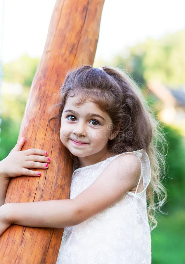 Portrait of smiling beautiful little girl at green of summer par royalty free stock images