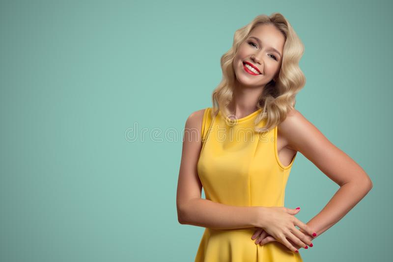 Pop art portrait of smiling beautiful woman against blue background stock photo