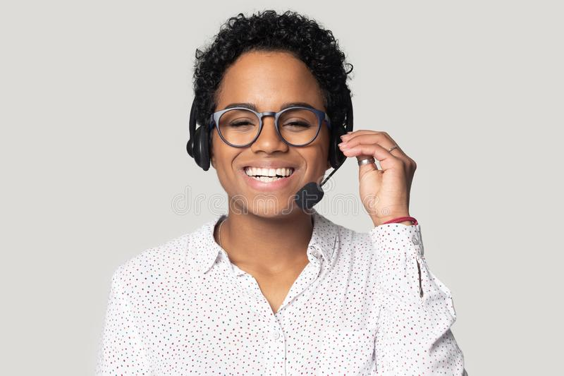 Portrait of smiling biracial female call center agent in headset royalty free stock photos