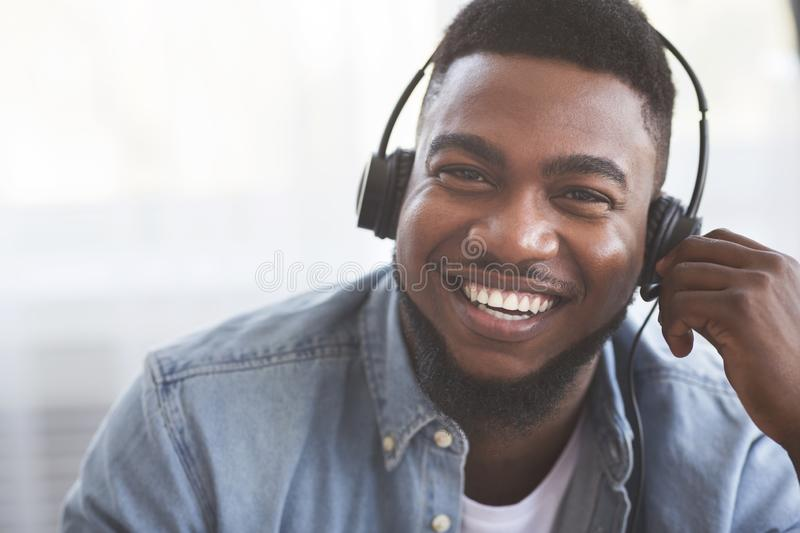 Portrait of smiling black call center operator in headset stock photos