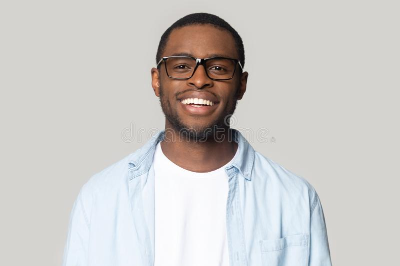 Portrait of smiling black man in glasses isolated in studio royalty free stock image