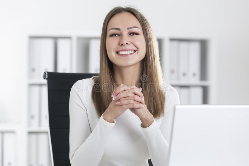 Portrait of smiling blond businesswoman in office royalty free stock images