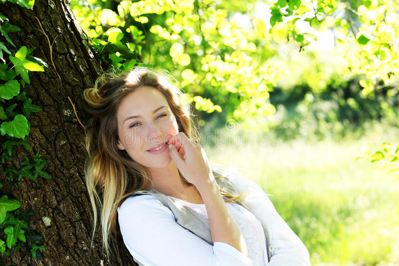 Portrait of smiling blond woman in forest royalty free stock photos