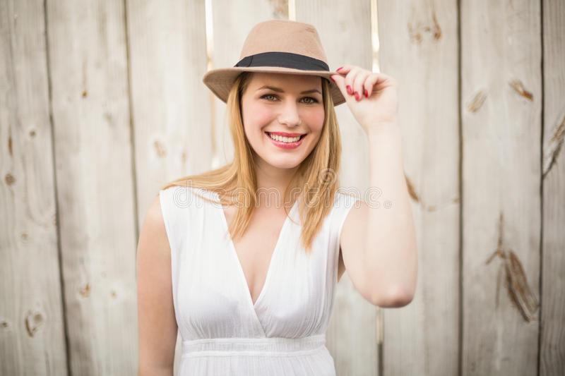 Portrait of a smiling blonde wearing hat royalty free stock photo