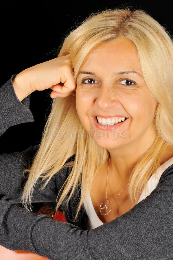 Portrait of smiling blonde woman. royalty free stock photo