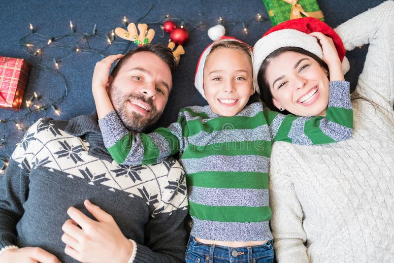 Happy Loving Family Lying At Home In Christmas Time royalty free stock images