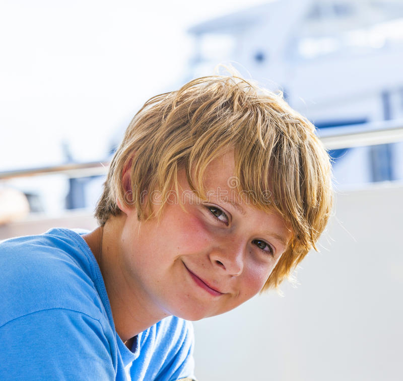 Boy Hair Images Download: Portrait Of A Smiling Boy With Blonde Hair Stock Photo