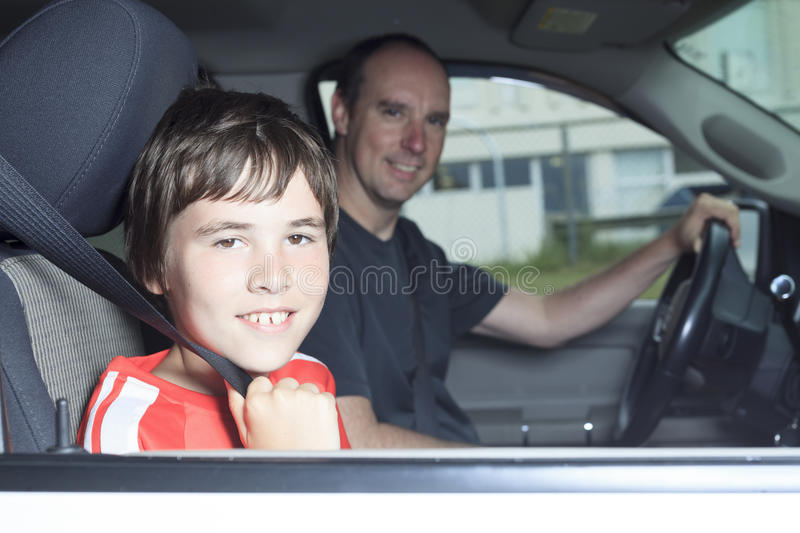 Portrait of smiling boy in the car of his father stock photos