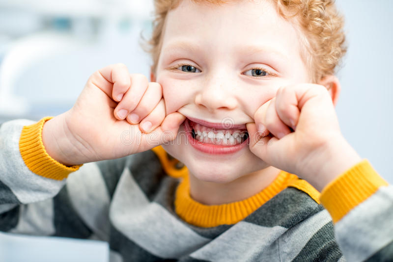 Portrait of a smiling boy at the dental office stock photos