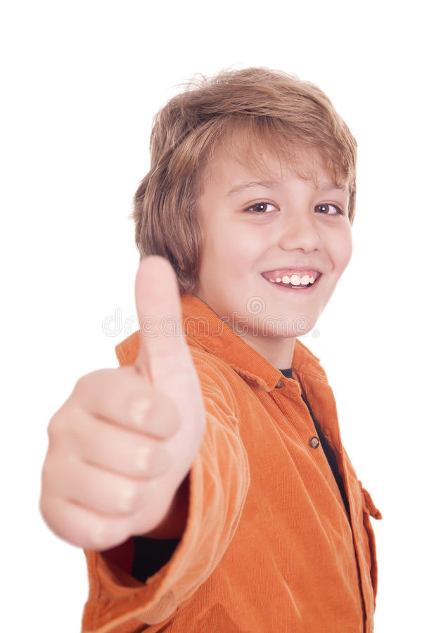 Portrait Of A Smiling Boy Holding His Thumb Up Stock Photo
