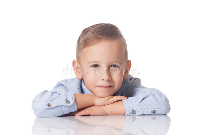 Portrait of a smiling boy. Studio portrait of a positive and smiling boy on isolated white stock image